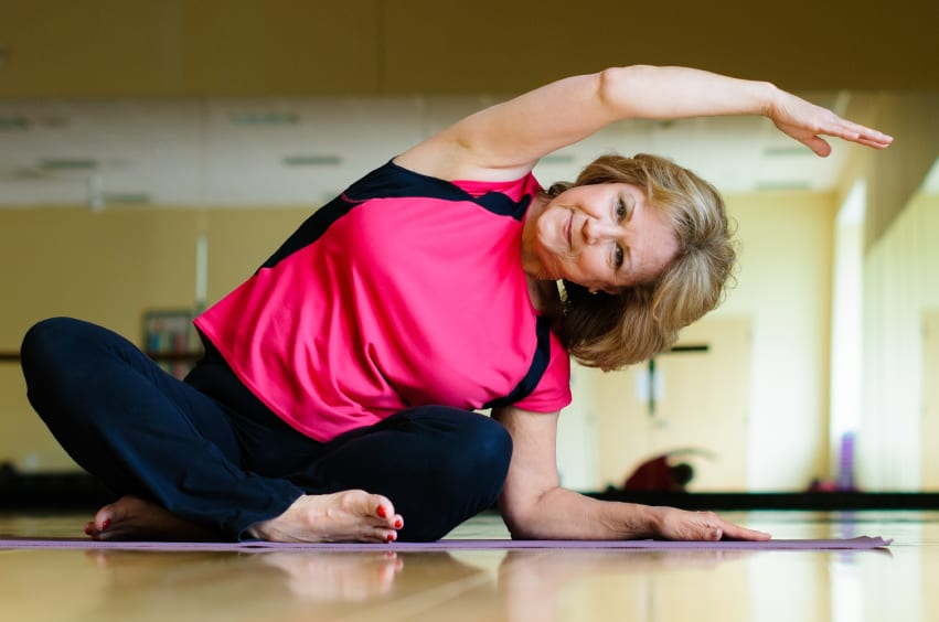 Mature Woman Does Yoga Side Bend